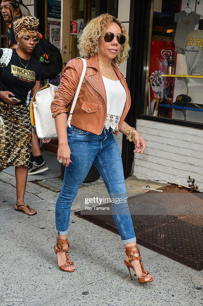 Singer Tameka 'Tiny' Cottle enters the 'Entertainment Tonight' taping at a Midtown Manhattan office building on July 30, 2014 in New York City.
