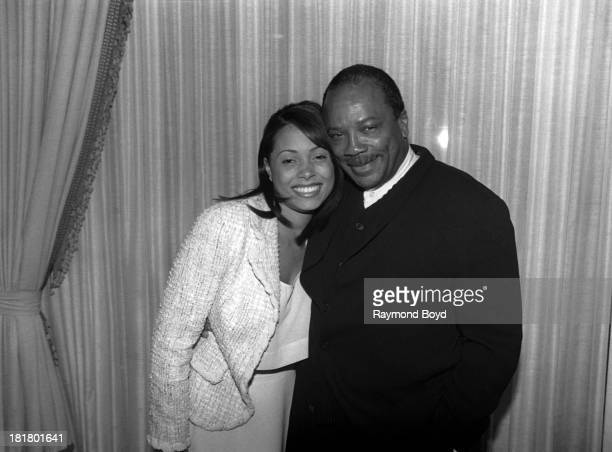 Singer Tamia and band leader and producer Quincy Jones poses for photos at the Ritz Carlton Hotel in Chicago Illinois in SEPTEMBER 1995