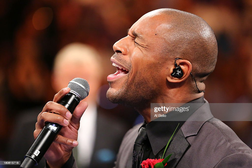 Singer Tank performs the national anthem before the Floyd Mayweather Jr. and Canelo Alvarez WBC/WBA 154-pound title fight at the MGM Grand Garden Arena on September 14, 2013 in Las Vegas, Nevada.