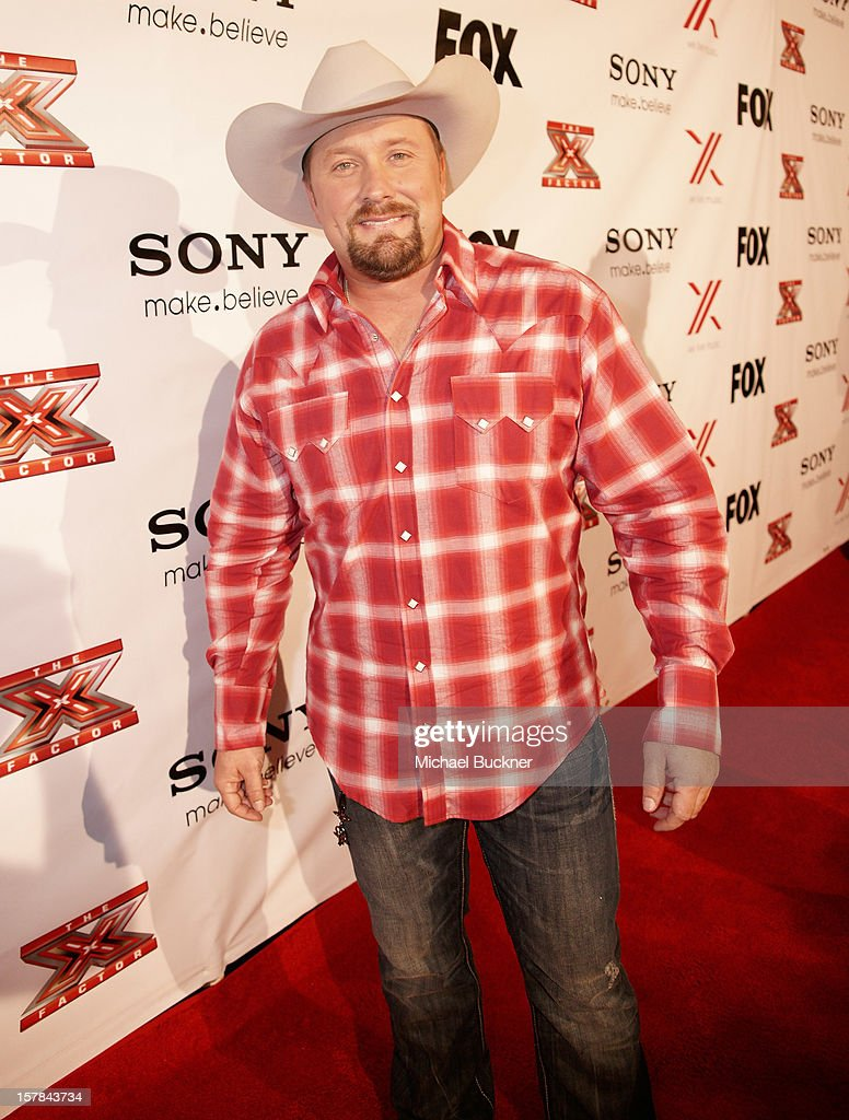 Singer <a gi-track='captionPersonalityLinkClicked' href=/galleries/search?phrase=Tate+Stevens&family=editorial&specificpeople=9748309 ng-click='$event.stopPropagation()'>Tate Stevens</a> attends The X Factor Viewing Party Sponsored By Sony X Headphones at Mixology101 & Planet Dailies on December 6, 2012 in Los Angeles, United States.