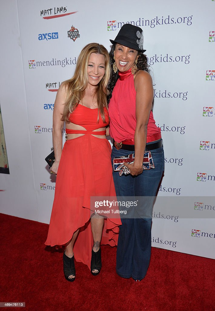 Singer Taylor Dane and former MTV VJ Julie Brown attend the Mending Kids International's 'Rock & Roll All-Stars' Fundraising Event on February 14, 2014 in Hollywood, California.