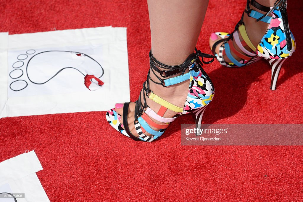 Singer Taylor Dye, shoe detail, attends the 2016 American Country Countdown Awards at The Forum on May 1, 2016 in Inglewood, California.