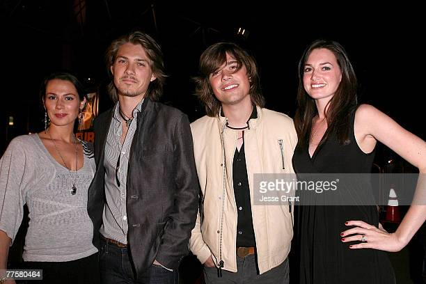 Singer Taylor Hanson and wife Natalie and singer Zac Hanson and wife Kate arrive at the 'Darfur Now' Los Angeles screening at the Directors Guild of...