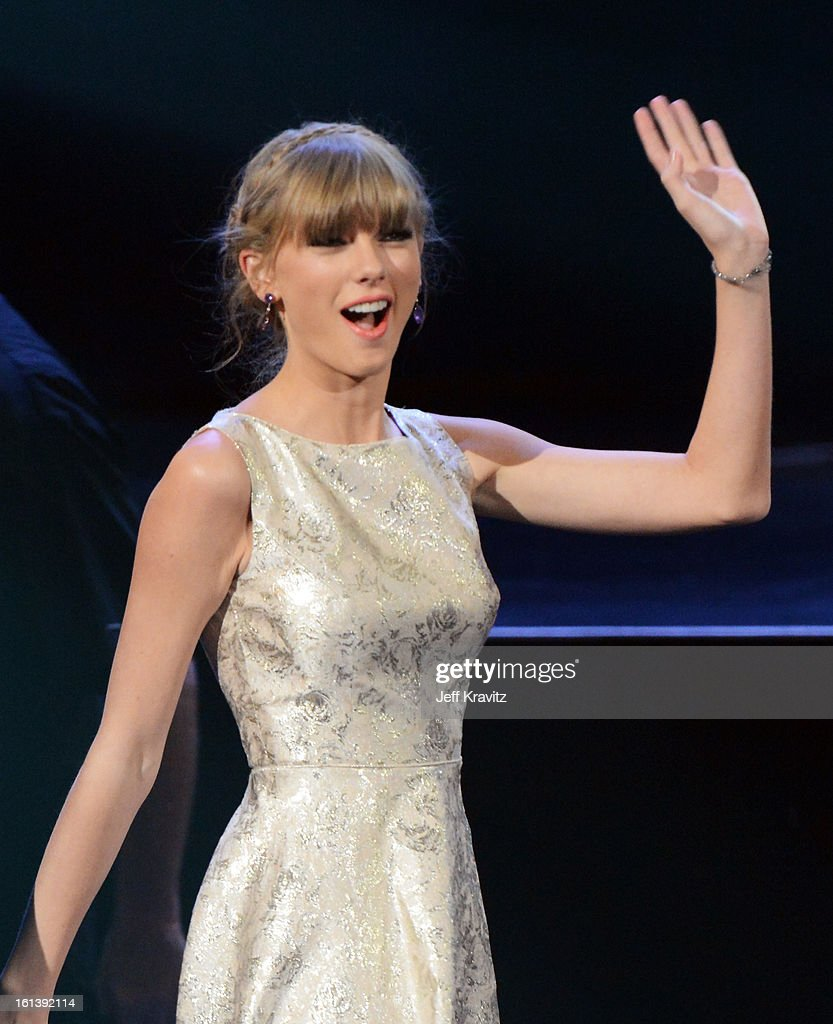 Singer <a gi-track='captionPersonalityLinkClicked' href=/galleries/search?phrase=Taylor+Swift&family=editorial&specificpeople=619504 ng-click='$event.stopPropagation()'>Taylor Swift</a> accepts an award onstage during the 55th Annual GRAMMY Awards at Nokia Theatre L.A. Live on February 10, 2013 in Los Angeles, California.