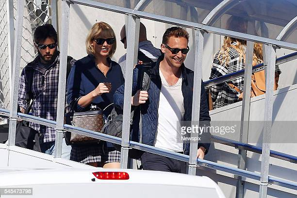 Singer Taylor Swift and actor Tom Hiddleston disembark their plane at Gold Coast Airport in Coolangatta Queensland