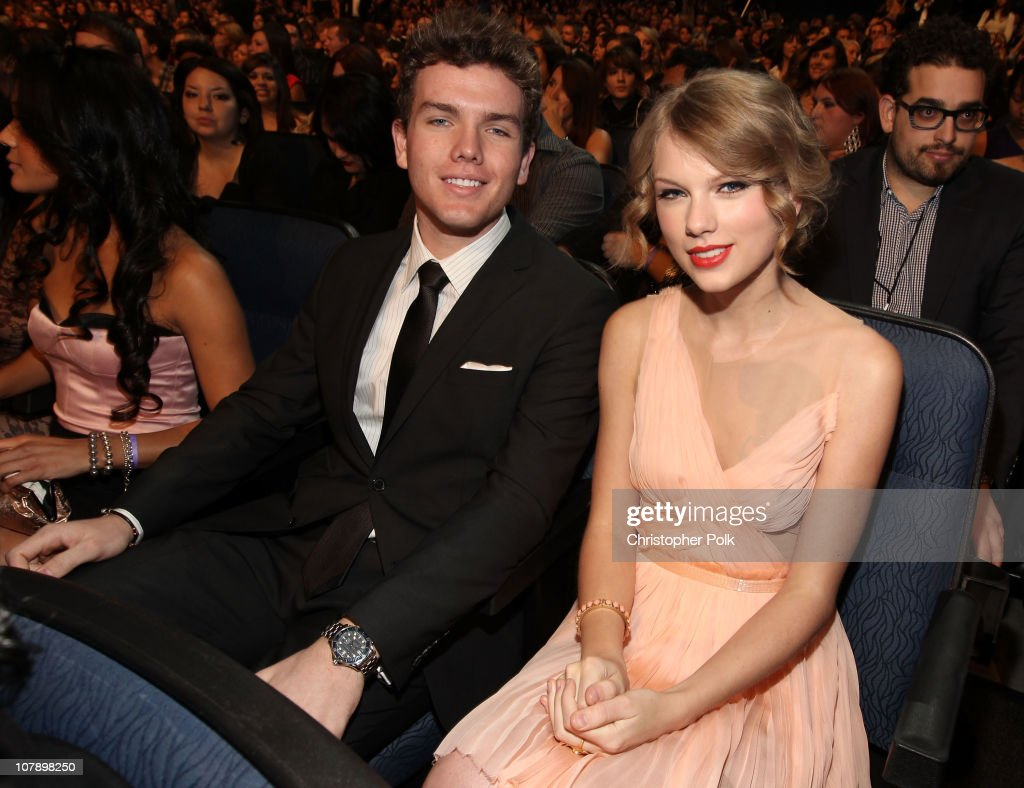 Singer <a gi-track='captionPersonalityLinkClicked' href=/galleries/search?phrase=Taylor+Swift&family=editorial&specificpeople=619504 ng-click='$event.stopPropagation()'>Taylor Swift</a> (R) and brother Austin Swift attend the 2011 People's Choice Awards at Nokia Theatre L.A. Live on January 5, 2011 in Los Angeles, California.
