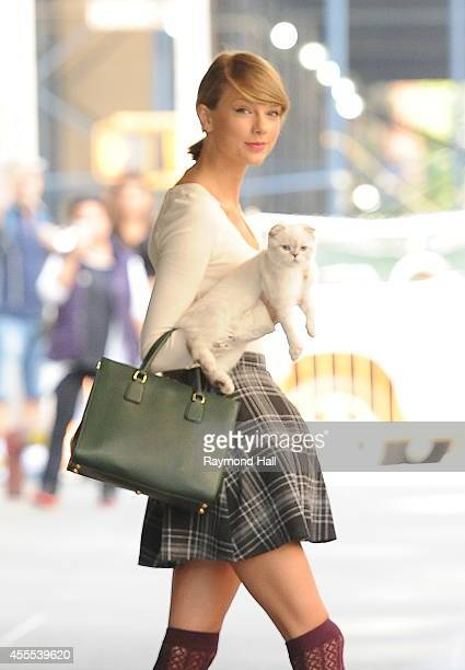 Singer Taylor Swift and Cat are seen in Soho on September 16 2014 in New York City