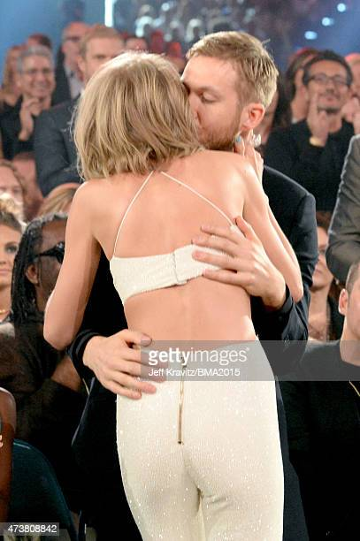 Singer Taylor Swift and DJ Calvin Harris embrace during the 2015 Billboard Music Awards at MGM Grand Garden Arena on May 17 2015 in Las Vegas Nevada
