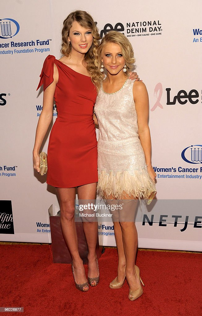 Singer Taylor Swift (L) and singer Julianne Hough arrive at An Unforgettable Evening Benefiting EIF's Women's Cancer Research Fund at Beverly Wilshire Four Seasons Hotel on January 27, 2010 in Beverly Hills, California.