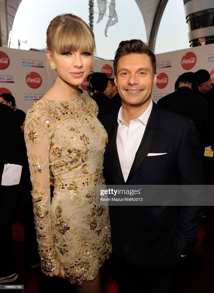 Singer Taylor Swift and television personality Ryan Seacrest attend the 40th American Music Awards held at Nokia Theatre L.A. Live on November 18, 2012 in Los Angeles, California.