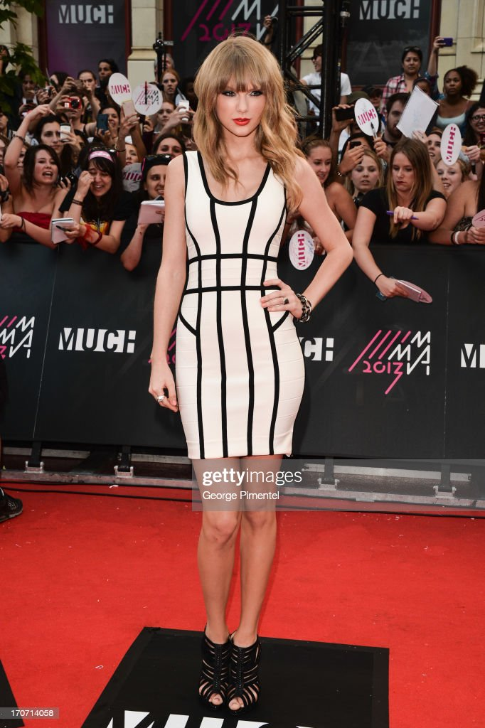 Singer <a gi-track='captionPersonalityLinkClicked' href=/galleries/search?phrase=Taylor+Swift&family=editorial&specificpeople=619504 ng-click='$event.stopPropagation()'>Taylor Swift</a> arrives at the 2013 MuchMusic Video Awards at MuchMusic HQ on June 16, 2013 in Toronto, Canada.