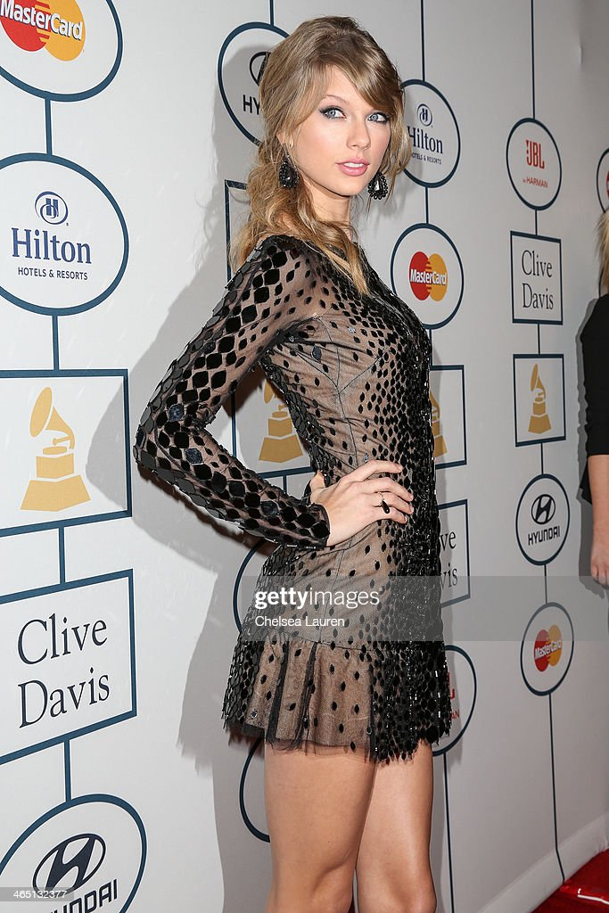 Singer <a gi-track='captionPersonalityLinkClicked' href=/galleries/search?phrase=Taylor+Swift&family=editorial&specificpeople=619504 ng-click='$event.stopPropagation()'>Taylor Swift</a> arrives at the 2014 HYUNDAI / GRAMMYs Clive Davis Pre-GRAMMY Gala Activation + Equus Fleet Arrivals at The Beverly Hilton Hotel on January 25, 2014 in Beverly Hills, California.