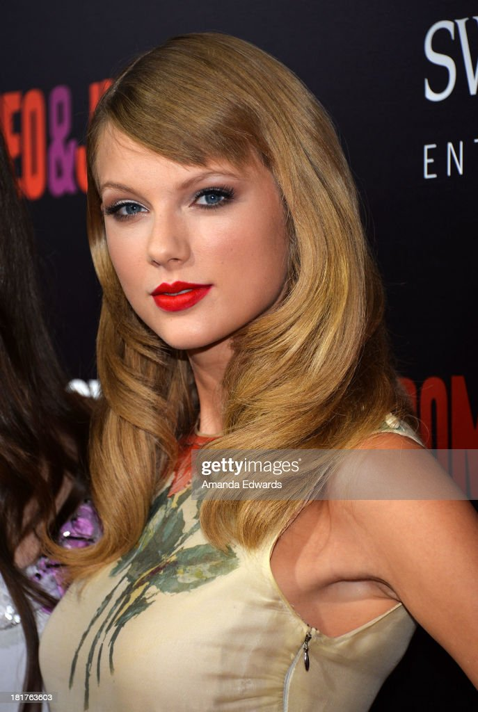 Singer <a gi-track='captionPersonalityLinkClicked' href=/galleries/search?phrase=Taylor+Swift&family=editorial&specificpeople=619504 ng-click='$event.stopPropagation()'>Taylor Swift</a> arrives at the world premiere of 'Romeo and Juliet' at the ArcLight Hollywood on September 24, 2013 in Hollywood, California.