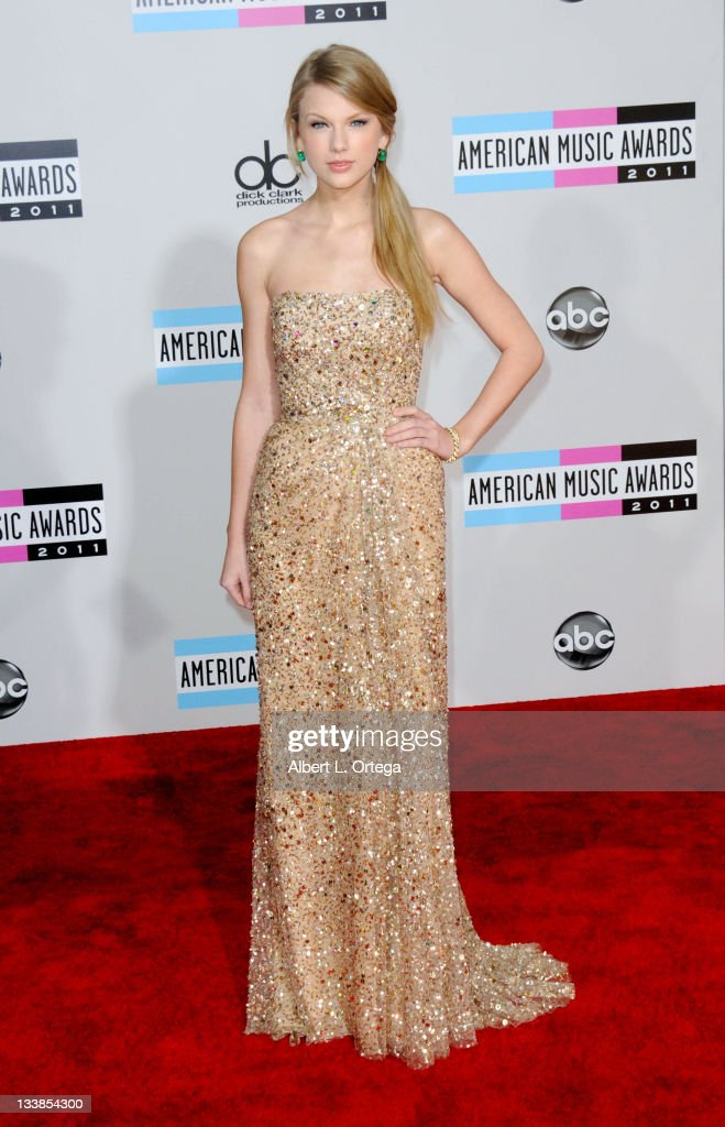 Singer <a gi-track='captionPersonalityLinkClicked' href=/galleries/search?phrase=Taylor+Swift&family=editorial&specificpeople=619504 ng-click='$event.stopPropagation()'>Taylor Swift</a> arrives for the 2011 American Music Awards held at Nokia Theater at L.A. Live on November 20, 2011 in Los Angeles, California.