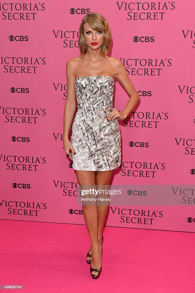 Singer <a gi-track='captionPersonalityLinkClicked' href=/galleries/search?phrase=Taylor+Swift&family=editorial&specificpeople=619504 ng-click='$event.stopPropagation()'>Taylor Swift</a> attends the pink carpet of the 2014 Victoria's Secret Fashion Show on December 2, 2014 in London, England.