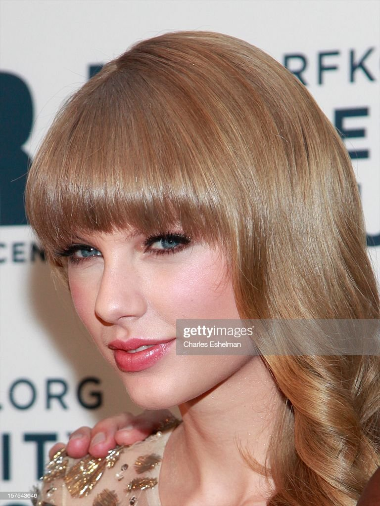 Singer <a gi-track='captionPersonalityLinkClicked' href=/galleries/search?phrase=Taylor+Swift&family=editorial&specificpeople=619504 ng-click='$event.stopPropagation()'>Taylor Swift</a> attends the Robert F. Kennedy Center for Justice and Human Rights 2012 Ripple of Hope gala at The New York Marriott Marquis on December 3, 2012 in New York City.