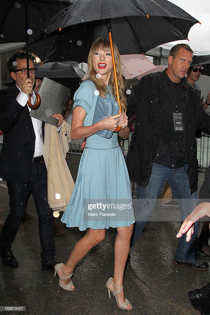 Singer <a gi-track='captionPersonalityLinkClicked' href=/galleries/search?phrase=Taylor+Swift&family=editorial&specificpeople=619504 ng-click='$event.stopPropagation()'>Taylor Swift</a> is seen leaving the Elie Saab Spring/Summer 2013 show as part of Paris Fashion Week at Espace Ephemere Tuileries on October 3, 2012 in Paris, France.