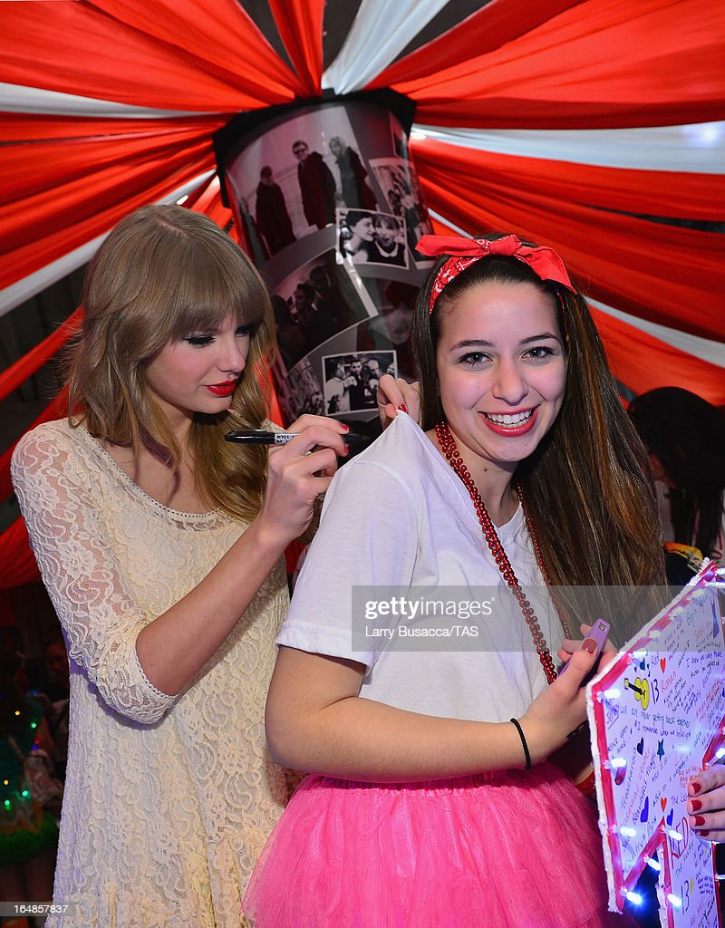 Singer Taylor Swift meets a fan in Club Red after her show at the Prudential Center on March 28, 2013 in Newark, New Jersey. Seven-time GRAMMY winner Taylor Swift plays 3 sold-out NY area shows at the Prudential Center this week on The RED Tour. Taylor plays electric guitar, banjo, piano and acoustic guitar and changes costumes 10 times over the course of the evening. The North American portion of The RED Tour will play 66 shows (including 13 stadium stops) in 47 cities in 29 states and 3 provinces spanning 6 months in 2013.