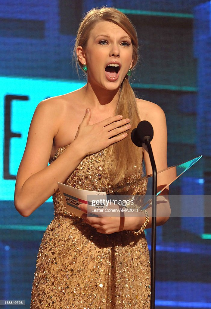 Singer <a gi-track='captionPersonalityLinkClicked' href=/galleries/search?phrase=Taylor+Swift&family=editorial&specificpeople=619504 ng-click='$event.stopPropagation()'>Taylor Swift</a> onstage at the 2011 American Music Awards held at Nokia Theatre L.A. LIVE on November 20, 2011 in Los Angeles, California.