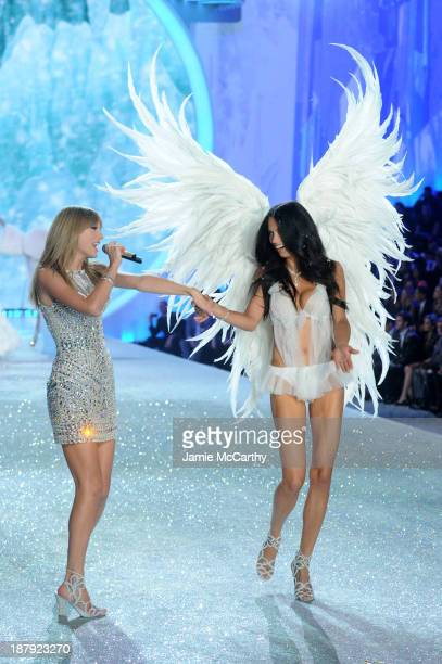 Singer Taylor Swift performs and model Adriana Lima walks the runway at the 2013 Victoria's Secret Fashion Show at Lexington Avenue Armory on...