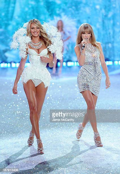 Singer Taylor Swift performs and model Candice Swanepoel walks the runway at the 2013 Victoria's Secret Fashion Show at Lexington Avenue Armory on...