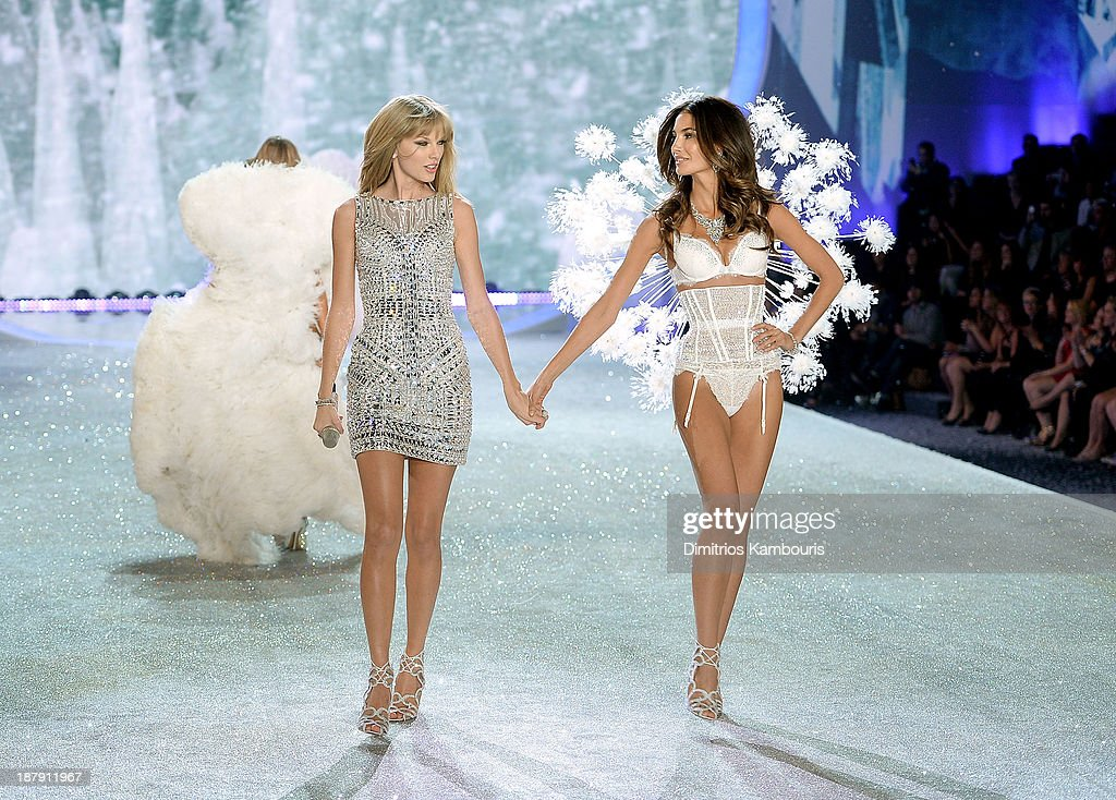 Singer Taylor Swift performs and model Lily Aldridge walks the runway at the 2013 Victoria's Secret Fashion Show at Lexington Avenue Armory on November 13, 2013 in New York City.
