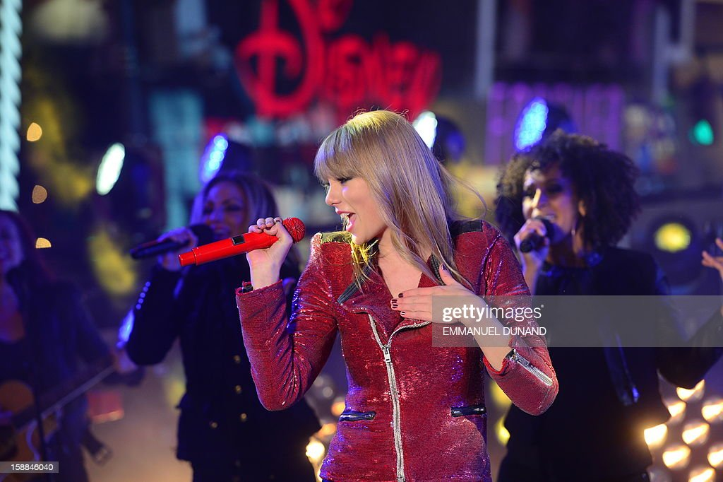 Singer Taylor Swift performs during New Year's celebrations on Times Square on December 31, 2012 in New York. A million people cheered in New York's Times Square as the traditional crystal ball dropped to mark the start of 2013, bringing a rolling global New Year's party that kicked off in Australia to US shores.