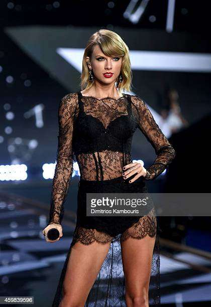 Singer Taylor Swift performs during the 2014 Victoria's Secret Fashion Show at Earl's Court Exhibition Centre on December 2 2014 in London England