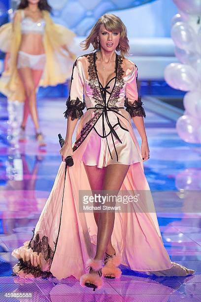 Singer Taylor Swift performs during the annual Victoria's Secret fashion show at Earls Court on December 2 2014 in London England