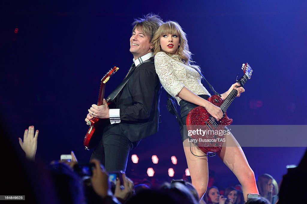 Singer <a gi-track='captionPersonalityLinkClicked' href=/galleries/search?phrase=Taylor+Swift&family=editorial&specificpeople=619504 ng-click='$event.stopPropagation()'>Taylor Swift</a> performs onstage at the Prudential Center on March 28, 2013 in Newark, New Jersey. Seven-time GRAMMY winner <a gi-track='captionPersonalityLinkClicked' href=/galleries/search?phrase=Taylor+Swift&family=editorial&specificpeople=619504 ng-click='$event.stopPropagation()'>Taylor Swift</a> plays 3 sold-out NY area shows at the Prudential Center this week on The RED Tour. Taylor plays electric guitar, banjo, piano and acoustic guitar and changes costumes 10 times over the course of the evening. The North American portion of The RED Tour will play 66 shows (including 13 stadium stops) in 47 cities in 29 states and 3 provinces spanning 6 months in 2013.