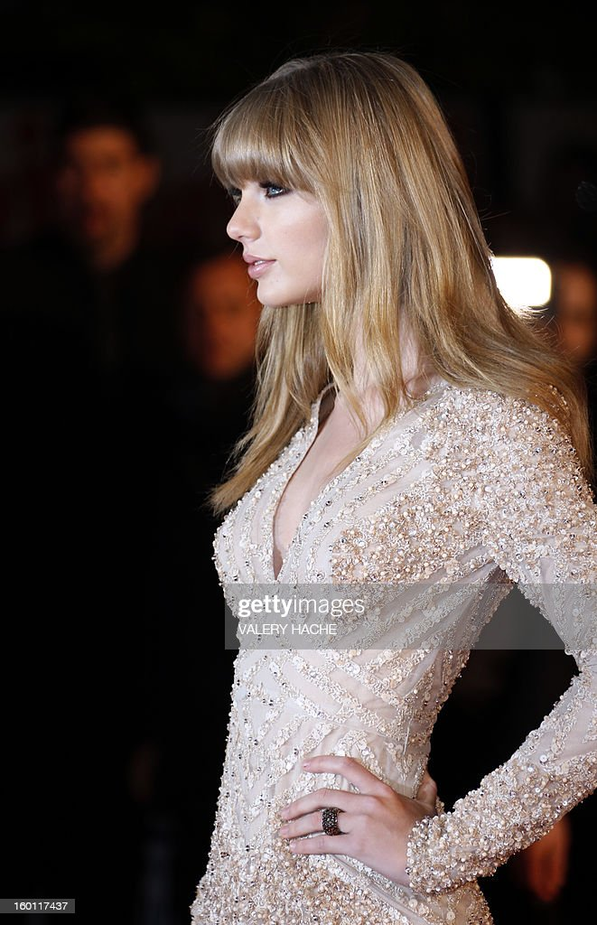 US singer Taylor Swift poses upon arrival at the Palais des Festivals during the 14th Annual NRJ Music Awards on January 26, 2013 in Cannes, southeastern France. News that the global music industry has finally turned the corner and is on the road to recovery should help get the annual four-day gathering of many of the world's top music execs at the MIDEM trade fair that opens here Saturday off to a good start.