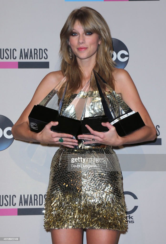 Singer <a gi-track='captionPersonalityLinkClicked' href=/galleries/search?phrase=Taylor+Swift&family=editorial&specificpeople=619504 ng-click='$event.stopPropagation()'>Taylor Swift</a> poses with her AMA awards in the press room at the 2013 American Music Awards at Nokia Theatre L.A. Live on November 24, 2013 in Los Angeles, California.