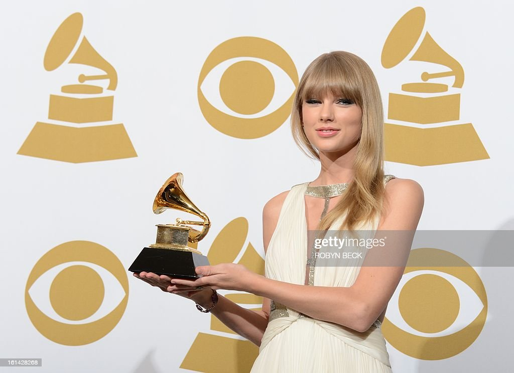 Singer Taylor Swift poses with her trophy for best song written for visual media for 'Safe and Sound' in the press room at the Staples Center during the 55th Grammy Awards in Los Angeles, California, February 10, 2013. AFP PHOTO Robyn BECK