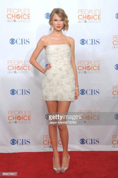 Singer Taylor Swift poses with the Favorite Female Artist Award in the press room during the People's Choice Awards 2010 held at Nokia Theatre LA...