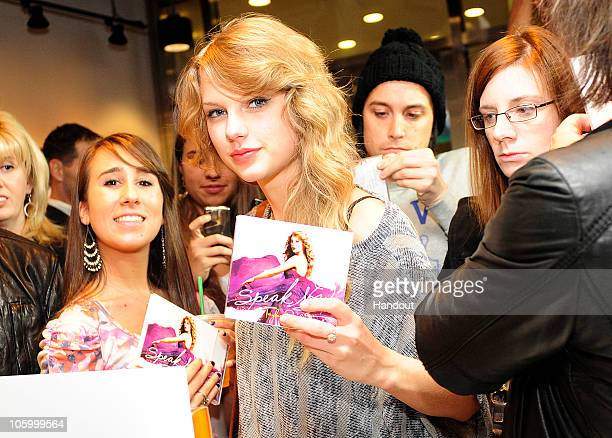 Singer Taylor Swift purchases her new album 'Speak Now' at the Times Square Starbucks on October 25 2010 in New York City The album is on sale at...