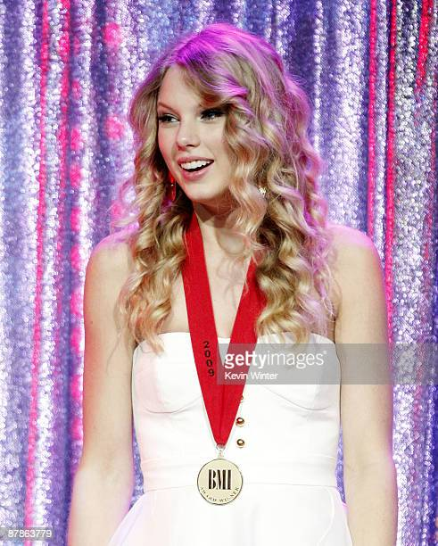 Singer Taylor Swift receives a songwriting award for 'Teardrops on my Guitar' at BMI's 57th Annual Pop Awards at the Beverly Wilshire Hotel on May 19...