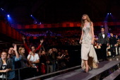 Singer Taylor Swift walks onstage to accept her award for Best Look during the MTV EMA's 2012 at Festhalle Frankfurt on November 11 2012 in Frankfurt...