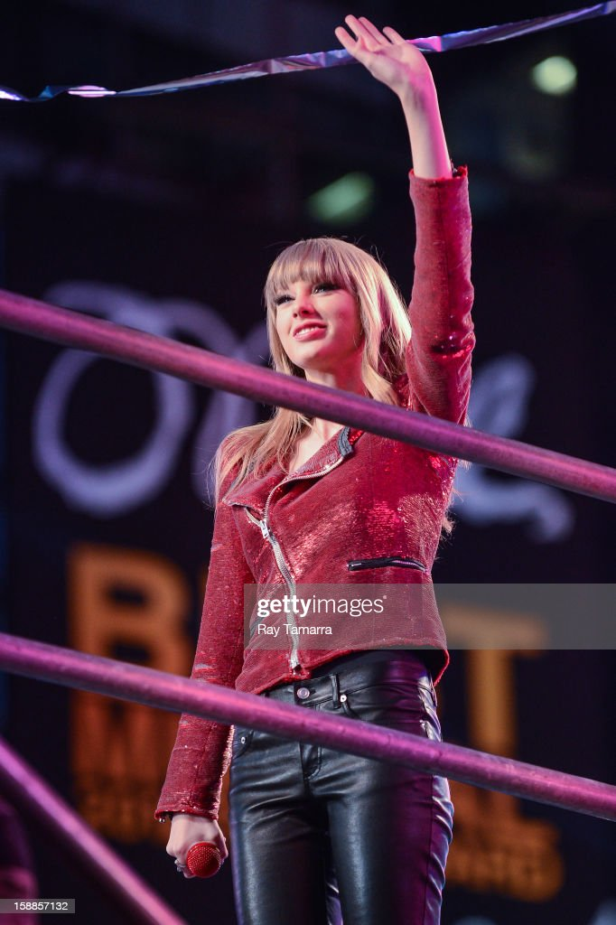 Singer Taylor Swift waves at the audience at the New Year's Eve 2013 in Times Square on December 31, 2012 in New York City.