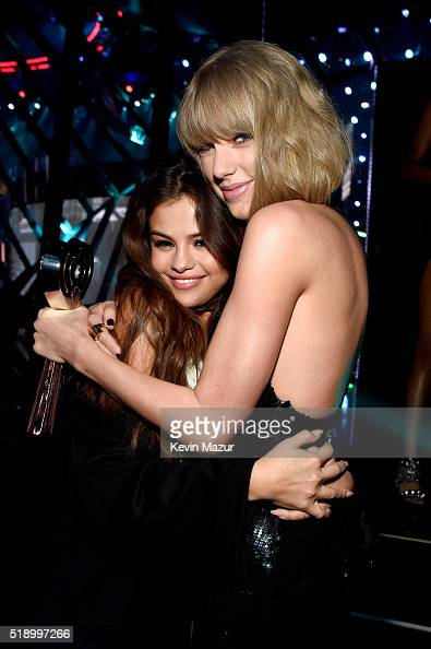 Singer Taylor Swift winner of the Album of the Year award for '1989' embraces actress/singer Selena Gomez backstage at the iHeartRadio Music Awards...