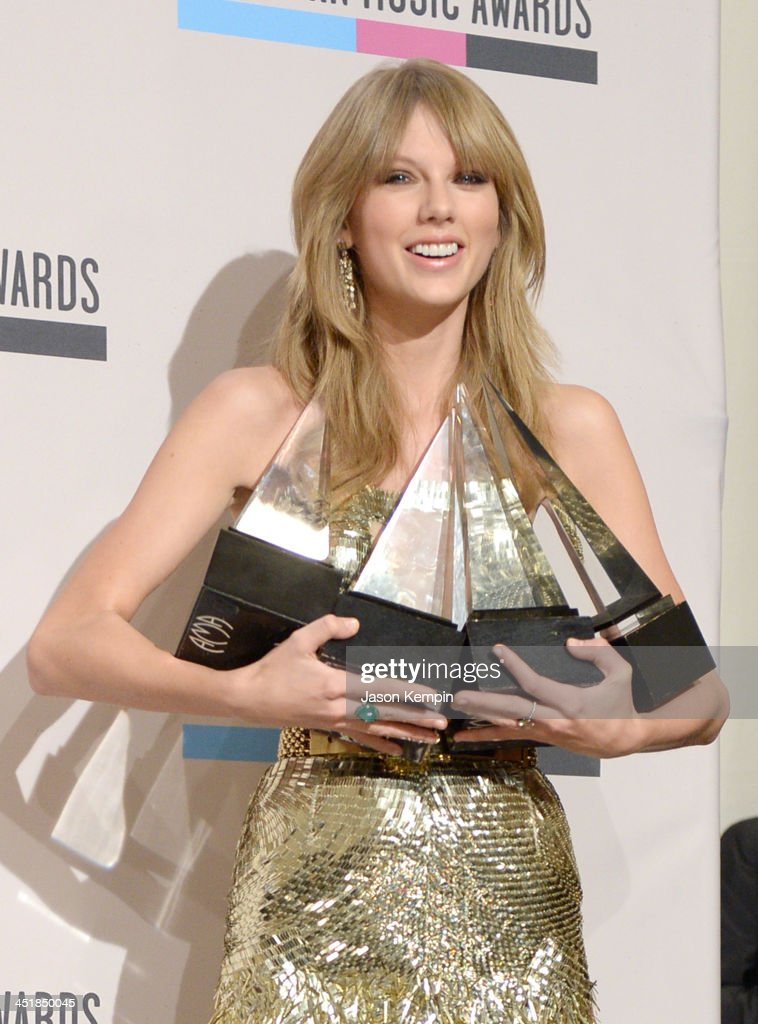 Singer <a gi-track='captionPersonalityLinkClicked' href=/galleries/search?phrase=Taylor+Swift&family=editorial&specificpeople=619504 ng-click='$event.stopPropagation()'>Taylor Swift</a>, winner of the Artist of the Year, Favorite Pop/Rock Female Artist, Favorite Country Female Artist, and Favorite Country Album awards, poses in the press room during the 2013 American Music Awards at Nokia Theatre L.A. Live on November 24, 2013 in Los Angeles, California.