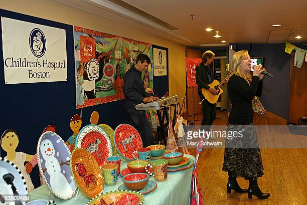 Singer Terri Clawson performs with Gary Pihl member of the band Boston during the launch party of Kidz B Kidz clothing line donating a portion of all...
