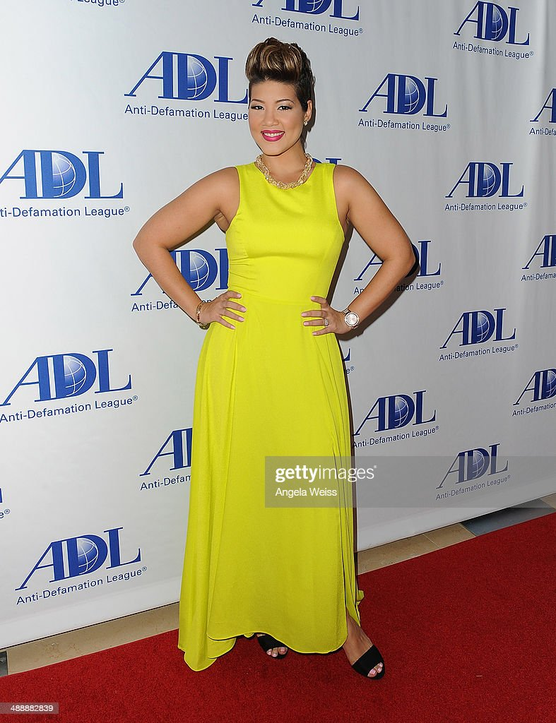 Singer <a gi-track='captionPersonalityLinkClicked' href=/galleries/search?phrase=Tessanne+Chin&family=editorial&specificpeople=11402587 ng-click='$event.stopPropagation()'>Tessanne Chin</a> arrives at the Anti-Defamation League entertainment industry dinner honoring Roma Downey and Mark Burnett at The Beverly Hilton Hotel on May 8, 2014 in Beverly Hills, California.