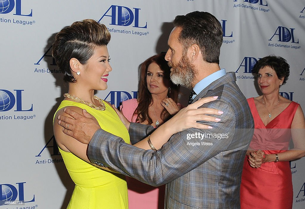 Singer Tessanne Chin producer Mark Burnett and actress/producer Roma Downey arrive at the AntiDefamation League entertainment industry dinner...