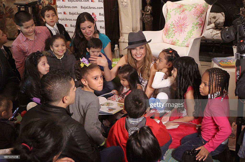 Singer <a gi-track='captionPersonalityLinkClicked' href=/galleries/search?phrase=Thalia&family=editorial&specificpeople=202218 ng-click='$event.stopPropagation()'>Thalia</a> with fans attend <a gi-track='captionPersonalityLinkClicked' href=/galleries/search?phrase=Thalia&family=editorial&specificpeople=202218 ng-click='$event.stopPropagation()'>Thalia</a>'s 'Chupie: The Binky That Returned Home' Book Launch Party at New York Public Library - Stephen A Schwartzman Building on November 6, 2013 in New York City.