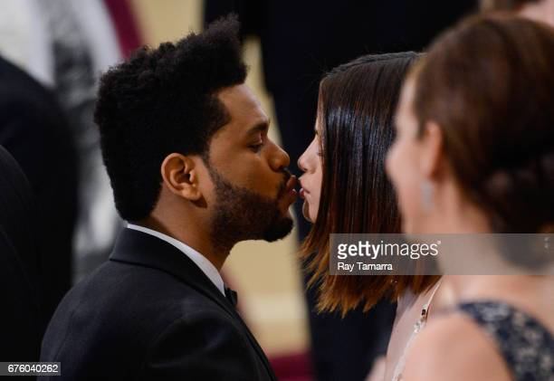 Singer The Weeknd and actress Selena Gomez enter the Rei Kawakubo/Comme des Garcons Art Of The InBetween' Costume Institute Gala at the Metropolitan...