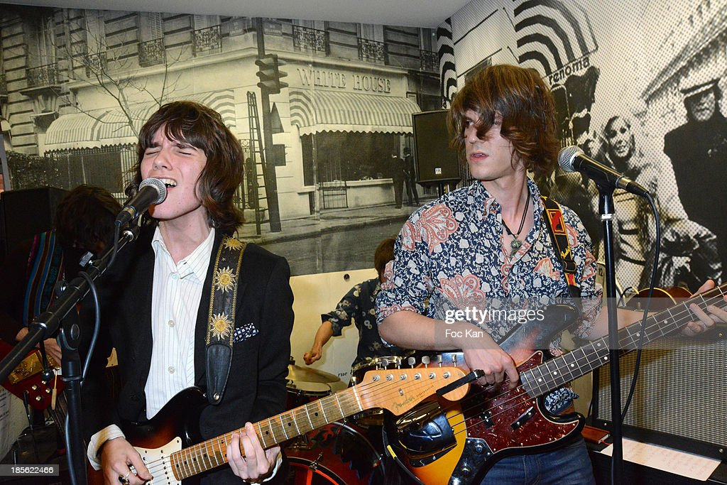 Singer Theo Berlioux and guitarist Felix Beguin from 'Velvet Veins' band perform during the 'Renoma 50th Anniversary' at Renoma Store Rue de La Pompe on October 22, 2013 in Paris, France.