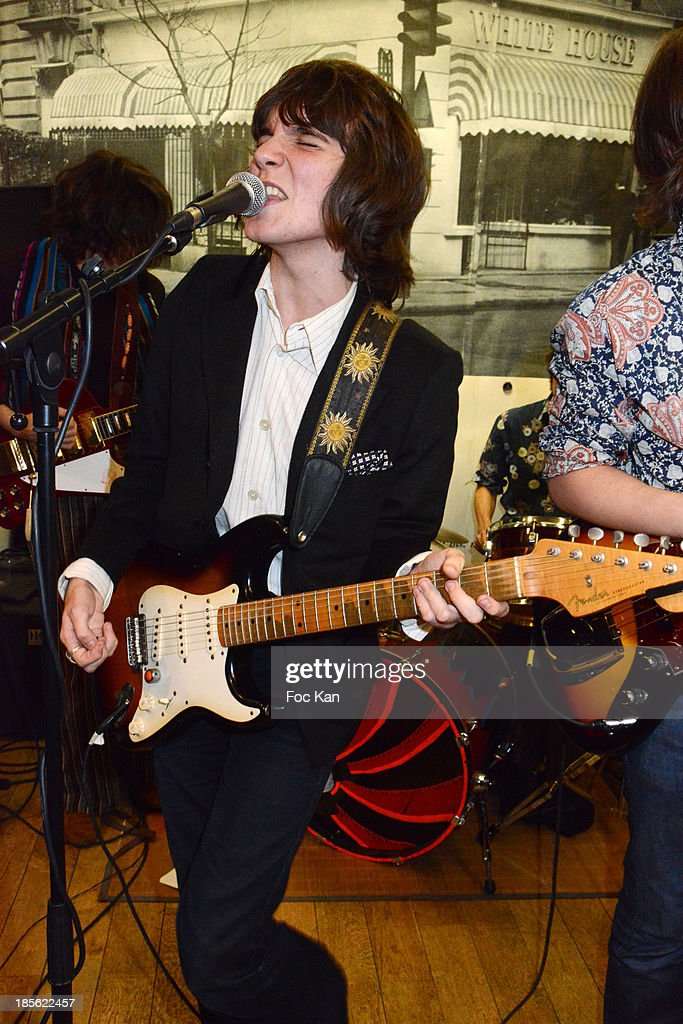 Singer Theo Berlioux from 'Velvet Veins' band performs during the 'Renoma 50th Anniversary' at Renoma Store Rue de La Pompe on October 22, 2013 in Paris, France.