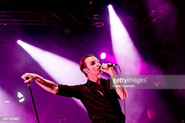 Singer Theo Hutchcraft of the British band Hurts performs live during a concert at the Energy Music Tour at the Kulturbrauerei on August 15 2015 in...
