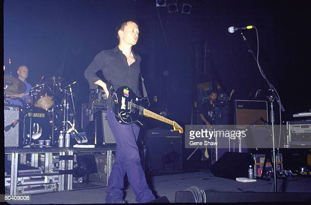 Singer Thom Yorke drummer Phil Selway performing w their band Radiohead
