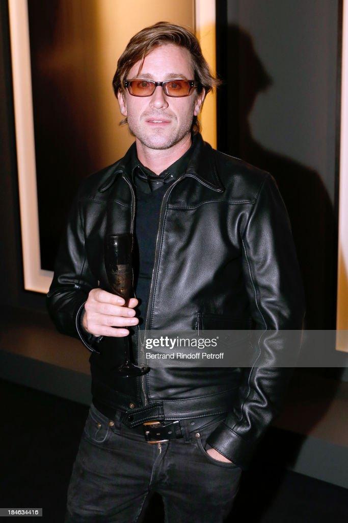 Singer Thomas Dutronc attends Boucheron Hosts Hiroshi Sugimoto Exhibition Celebration at Place Vendome Boucheron shop on October 14 2013 in Paris...